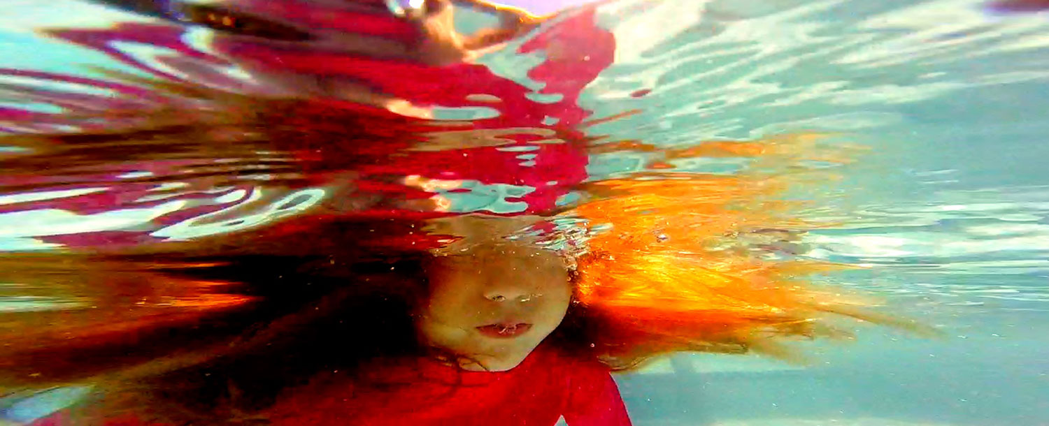 image of girl underwater by Design Five Seven